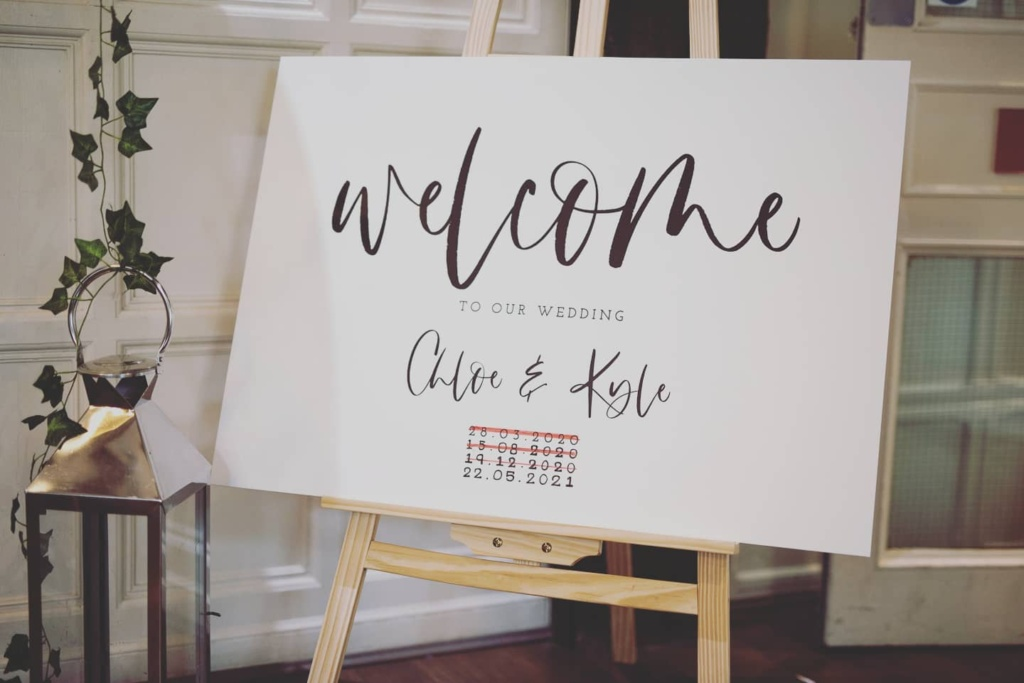 back in action wedding welcome board